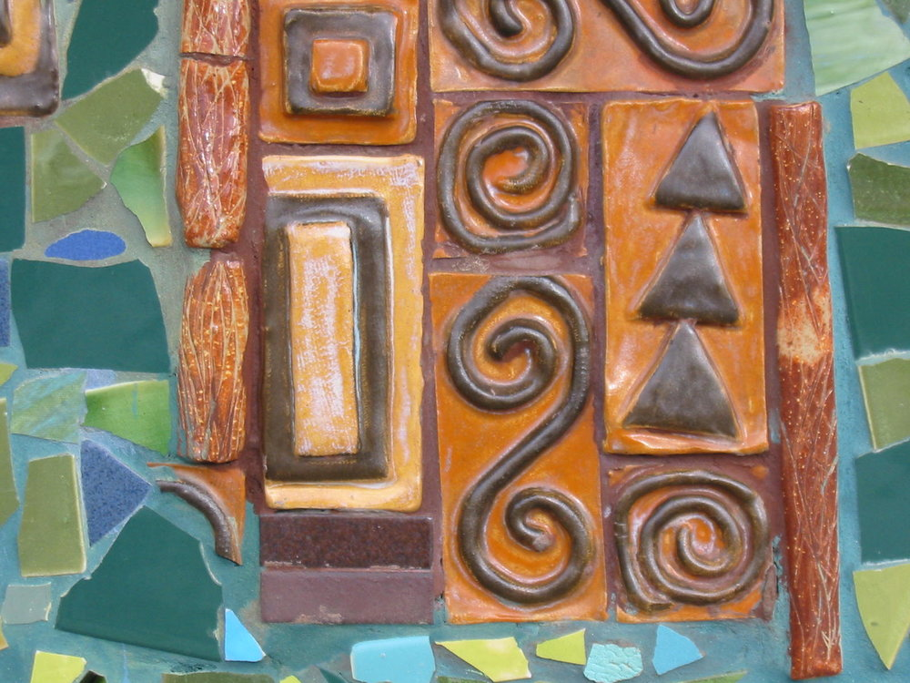close up of the redwood tree trunk tiles in the mural