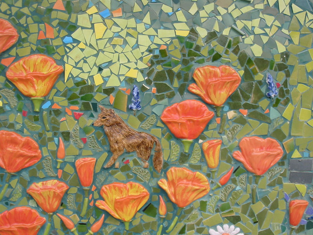 close up of poppy tiles in the mosaic mural