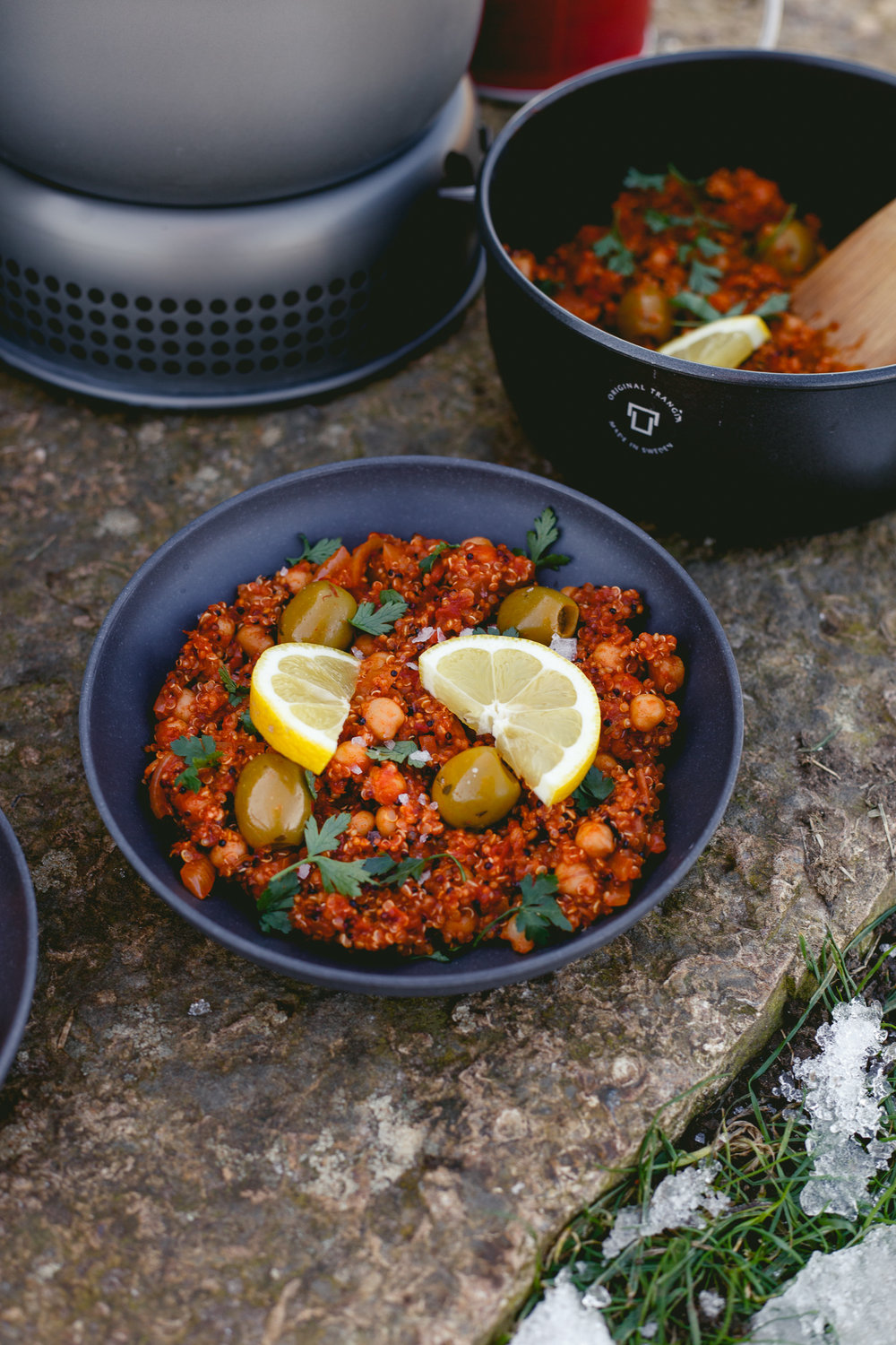 Ingredients - 2 tbsp smoked rapeseed oil (or olive oil)2 tsp smoked paprika1 tsp each cumin seeds, fennel seeds, rosemary + oregano1 large yellow onion, thinly sliced1 cup dry quinoa1 x 400g tin chickpeas, drained1 x 400g tin chopped tomatoes2 cups vegetable stock100g olivesFresh parsley1 x lemon to serveSea salt