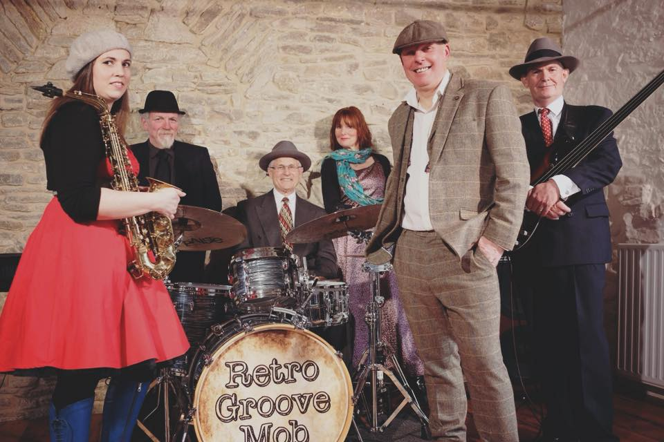 Retro Groove Mob - https://retrogroovemob.com/RGM bring their unique sound and energy to special events taking place in your world. They entertain and dazzle, with a fantastic repertoire of popular songs twisted with the RGM retro style.
