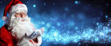 santa-claus-blowing-magic-christmas-stars