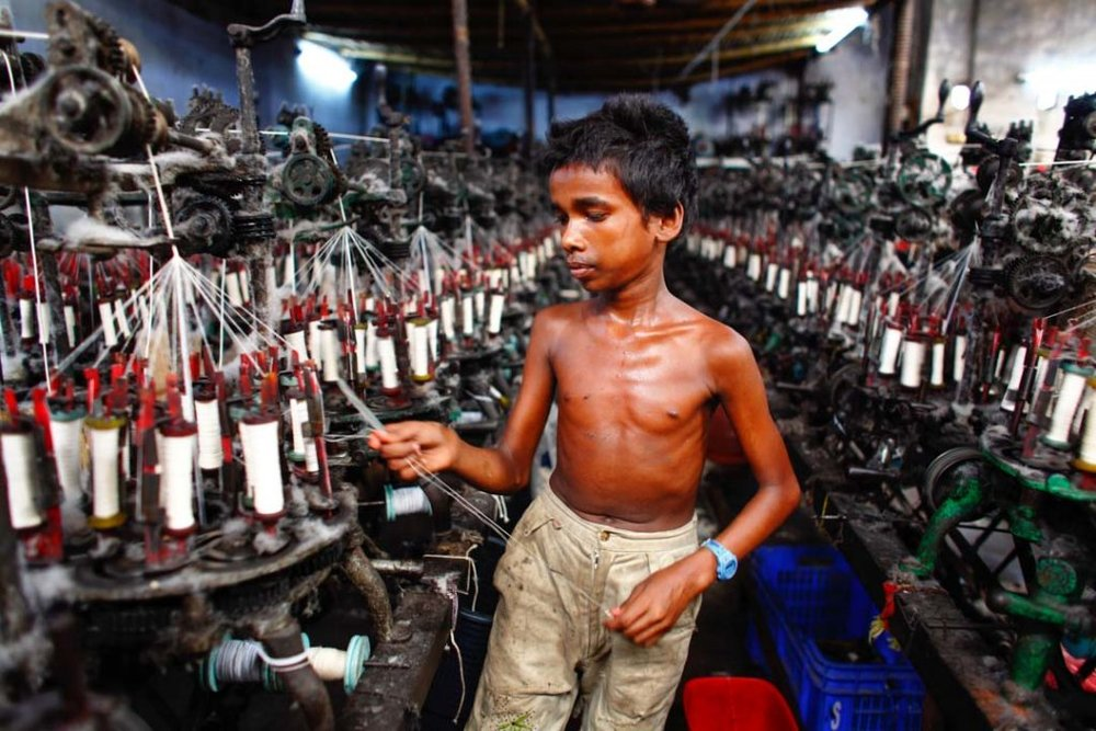 A child labor in the Fashion industry. Photo by  Collective Evolution