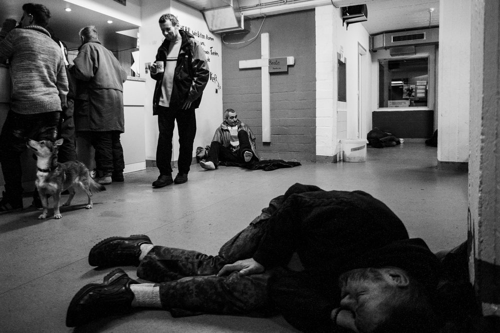 """Documenting social realities. Men and women sleeps where they can be safe. For many homeless it is almost impossible to sleep in the streets. As I wrote in """"Réagir"""" (Drug addicts are in the same situation) It is impossible because it is  not safe . A person trying to sleep in the streets can be attacked, robed and raped. That is why some of them are sleeping on the floor here. It's warm, safe, and they need to rest; unfortunately there was no more space to rest so they slept on the floor, it's better than a manhole in the streets."""