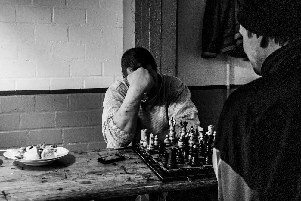 Though Russian guys first yeld at me, then agreed that I could photograph while they were playing chess. I noticed the scars on the arm and the marks on the table. It felt like a scene out of the 4oies, but no. It is 21 century in Europe. Berlin, Jan 2013.