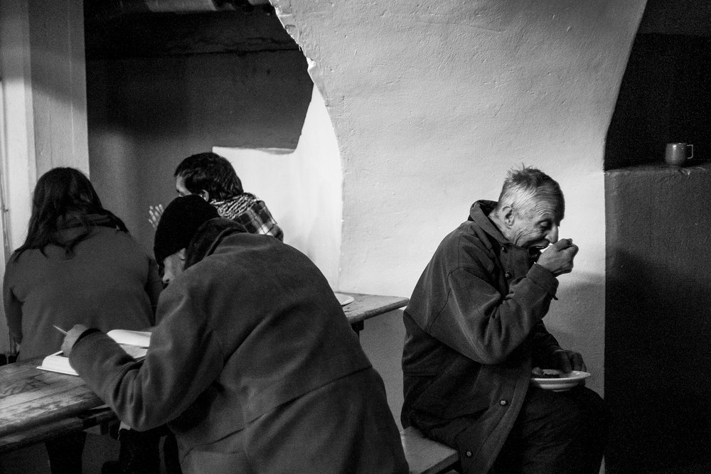 Later on, the man on the left reading his book. Then I had a nice talk with the man eating. Berlin, Jan 2013.