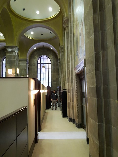 TUP Commerce Court Michael at end of aisle of cubicles in main granite lobby.jpg