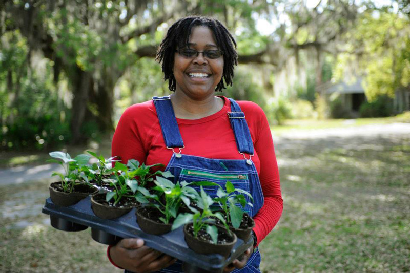 """Althea Raiford - Althea lives and works in Atlanta, but her passion for Gilliard Farms keeps her traveling back and forth 4 hours each way on the weekends to make sure work gets done.When her brother suggested they get back to the farm together about 10 years ago, Althea was still on active duty. As soon as the opportunity arose, she dove head first into farm life out of a deep interest in serving her community.""""This part of Brunswick is rural, and the stores for groceries are on the other side of town. We want to feed the people nearby good food and affordable food,"""" Althea says. """"We try to make it as accessible and affordable as possible, selling at farmers markets and being involved in the SNAP program [formerly known as food stamps].""""To Althea, the community interest is her personal interest. Farming after the military was a way to come home to both be better and to do better.""""Farming gave me a purpose. For a lot of us veterans, we feel kind of lost when we come back. Some of our skills don't really translate into the civilian world. You have to find a new method. That's one thing I learned in the military that translated into farming: adapting and overcoming.""""This proved a useful skill when a severe windstorm seriously damaged their hoop house and a large portion of their chicken flock. They needed to think of something to do with a smaller flock and a ruined hoop house. By throwing a shade cloth over the hoop house, they created a coop for their chickens and ducks.""""There's always going to be something that's unplanned for you to get around. Get your farm hack on and make it work!"""" she says.- from Meet The Modern Farmer: Military Edition"""