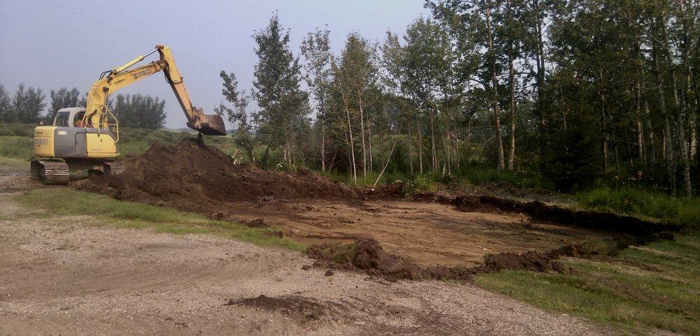 - A local contractor helped ready the plot for the foundation.