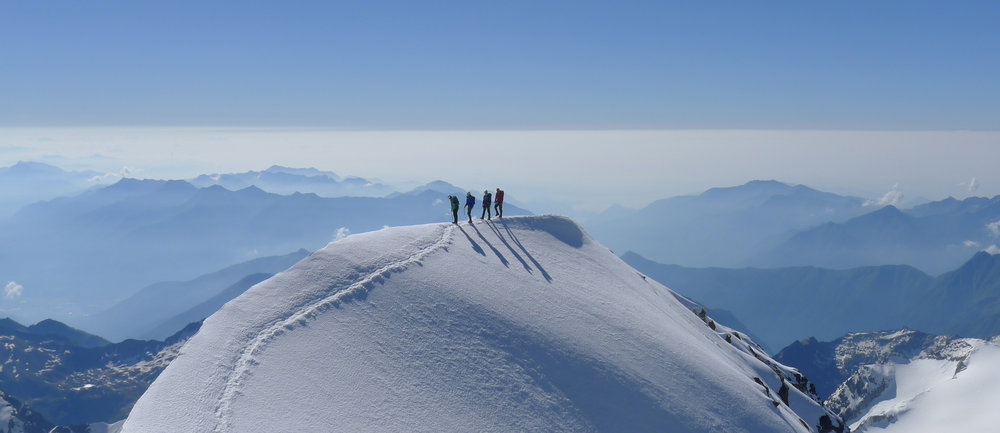 Your 1st 4000m peak? Neil Mackay guiding his team on the Weismeiss traverse, Swiss Alps