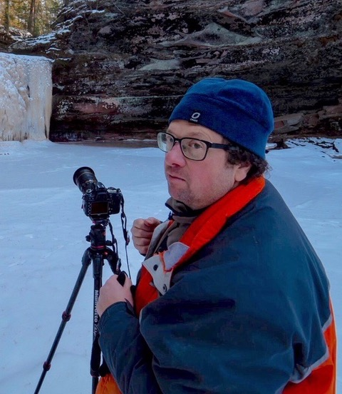 Photographer Jeremy Oswald shown on location at Twin Falls in Port Wing. Photo by Andrew Okey.