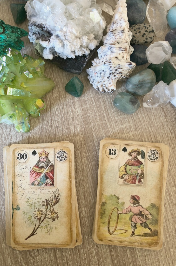 Lenormand Lily card combinations and interpretations. Learn how to combine the Lenormand Lily card for general, love, business, money, health and other types of readings. Here is how to combine Lily with Clover, Sun, Bouquet, Moon and other cards in your deck.