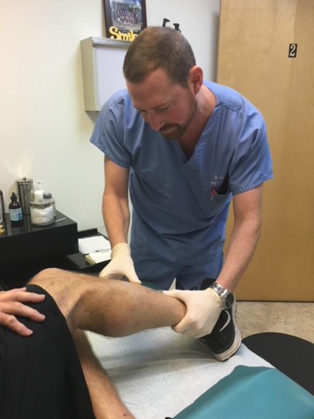 podiatrist cory hawley treating patient