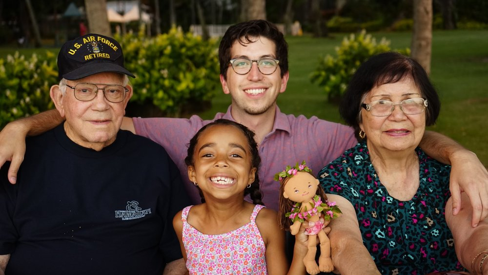 Brent, his cousin Piercey, and their grandparents Mike and Tiva in Hawaii