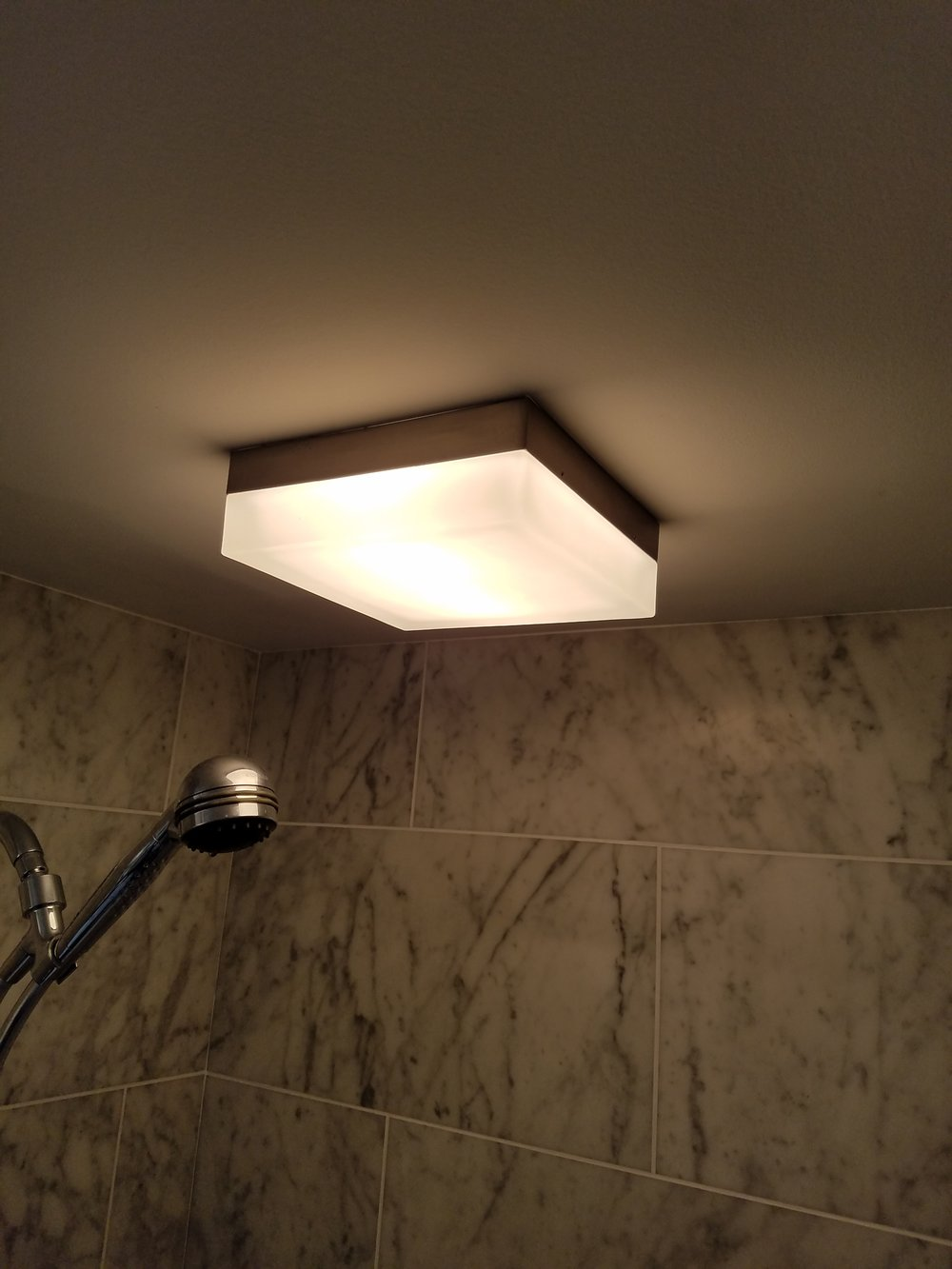 tiled shower and light.jpg