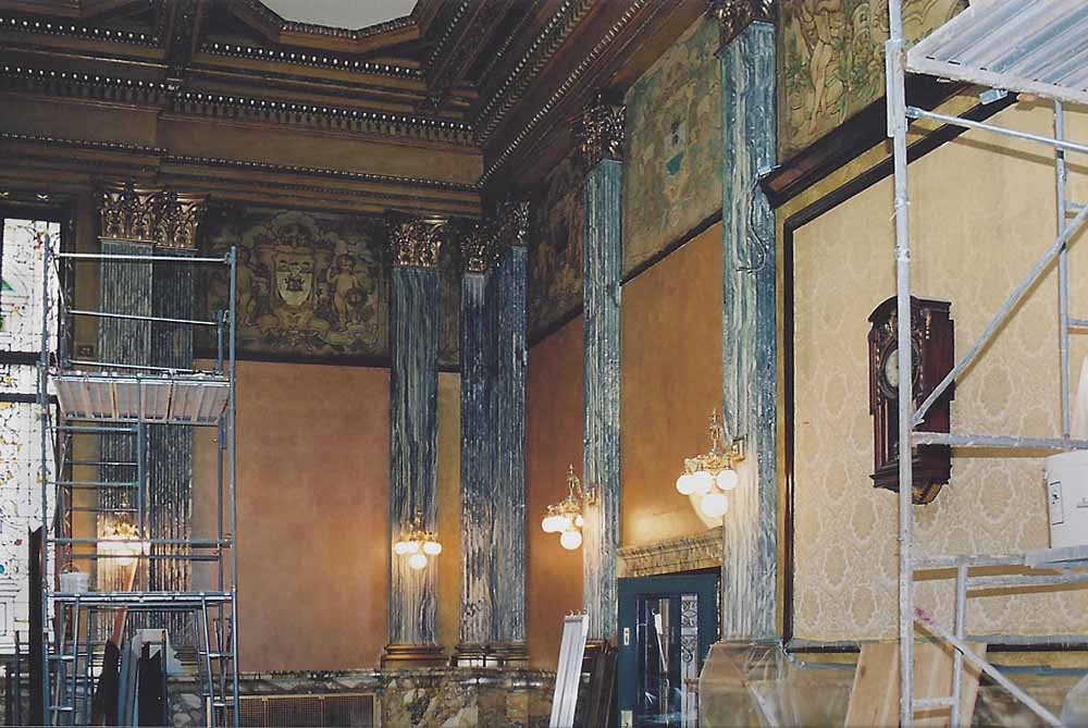 Courtroom exposure and conservation of original painted frieze