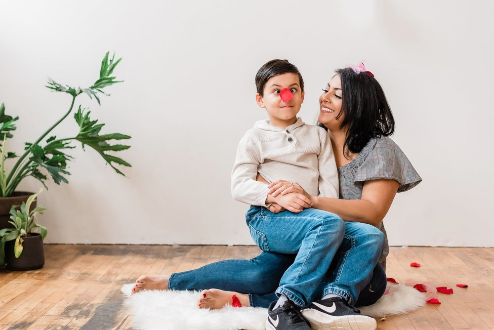 silly valentines day moment at family photoshoot in Portland, Oregon