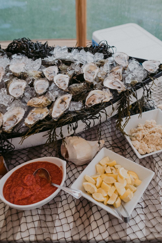 Same Sex Wedding in Provincetown, MA. Destination wedding planned by Nicole Simeral. Coastal Chic Wedding, Travel Wedding, Sperry Sailcloth Tent Wedding., Raw Bar, Seafood, Cocktail Hour, Boat