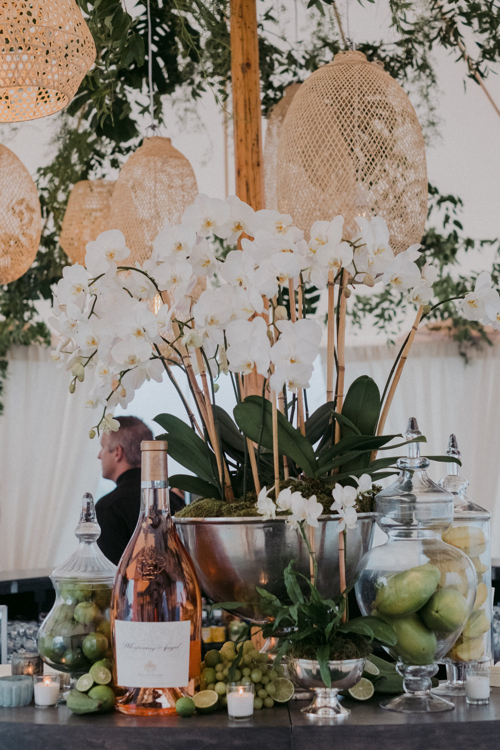 Same Sex Wedding in Provincetown, MA. Destination wedding planned by Nicole Simeral. Coastal Chic Wedding, Travel Wedding, Sperry Sailcloth Tent Wedding, bar flowers, orchid planter, orchids, trophy cup, whispering angel, gracious wedding