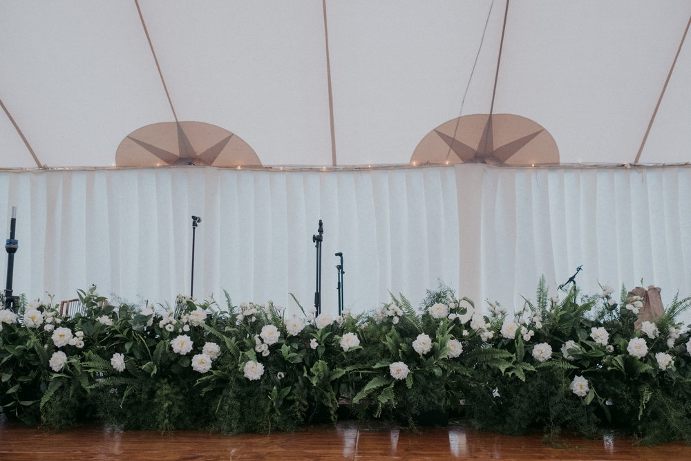 Same Sex Wedding in Provincetown, MA. Destination wedding planned by Nicole Simeral. Coastal Chic Wedding, Travel Wedding, Sperry Sailcloth Tent Wedding, bamboo folding chairs, Belfast linen, whites and greens ,symmetry , stage flowers