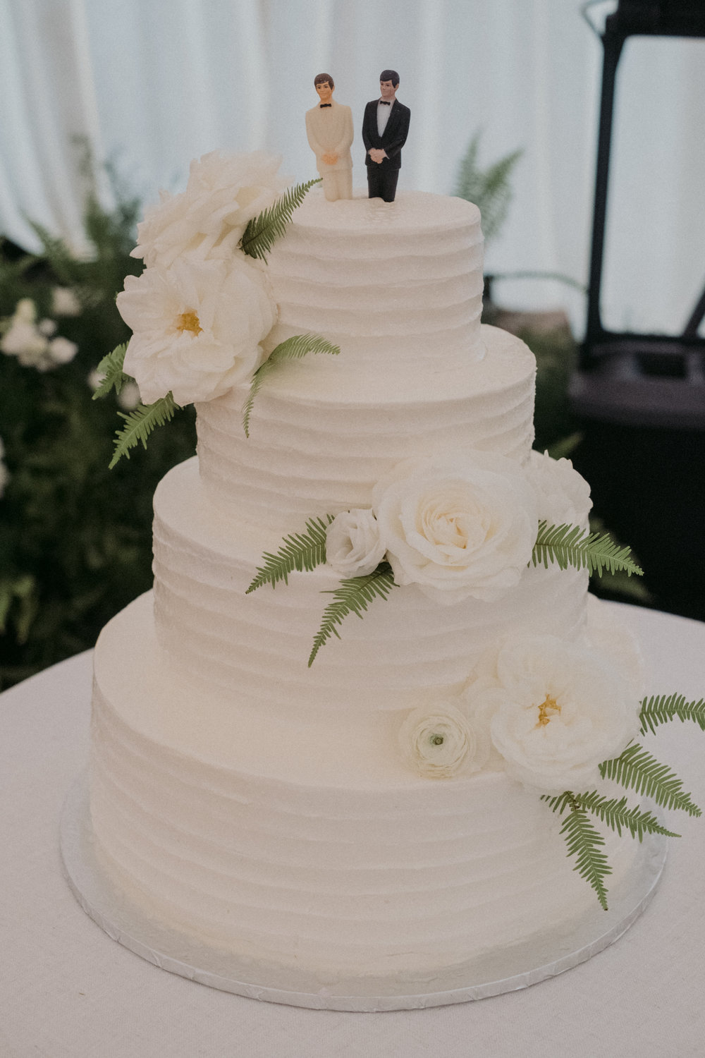 Same Sex Wedding in Provincetown, MA. Destination wedding planned by Nicole Simeral. Coastal Chic Wedding, Travel Wedding, Sperry Sailcloth Tent Wedding, bamboo folding chairs, Belfast linen, whites and greens , wedding cake, cake flowers, cake topper