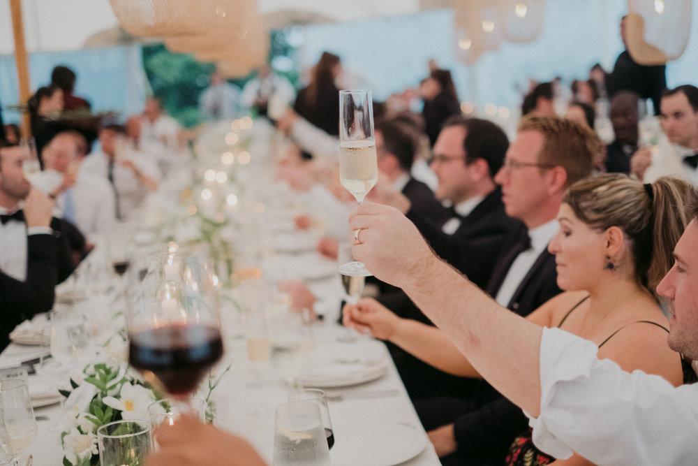 Same Sex Wedding in Provincetown, MA. Destination wedding planned by Nicole Simeral. Coastal Chic Wedding, Travel Wedding, Sperry Sailcloth Tent Wedding, bamboo folding chairs, Belfast linen, whites and greens , straw lantern, symmetry, toasts, speeches, wedding toast