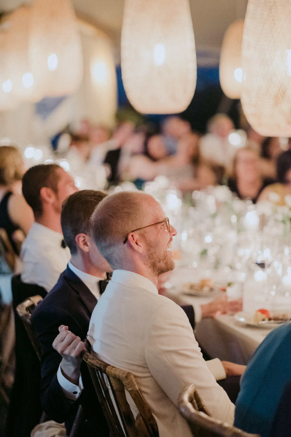 Same Sex Wedding in Provincetown, MA. Destination wedding planned by Nicole Simeral. Coastal Chic Wedding, Travel Wedding, Sperry Sailcloth Tent Wedding, bamboo folding chairs, Belfast linen, whites and greens , straw lantern, symmetry , wedding toast, best man, maid of honor speech