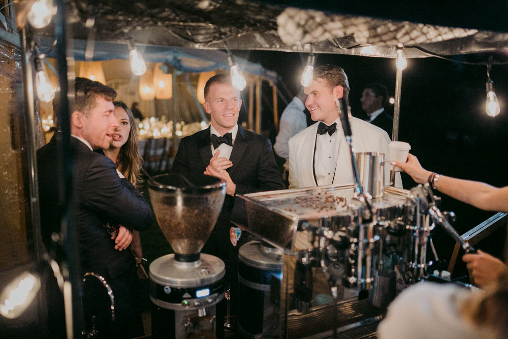 Same Sex Wedding in Provincetown, MA. Destination wedding planned by Nicole Simeral. Coastal Chic Wedding, Travel Wedding, Sperry Sailcloth Tent Wedding, bamboo folding chairs, Belfast linen, night time, espresso cart