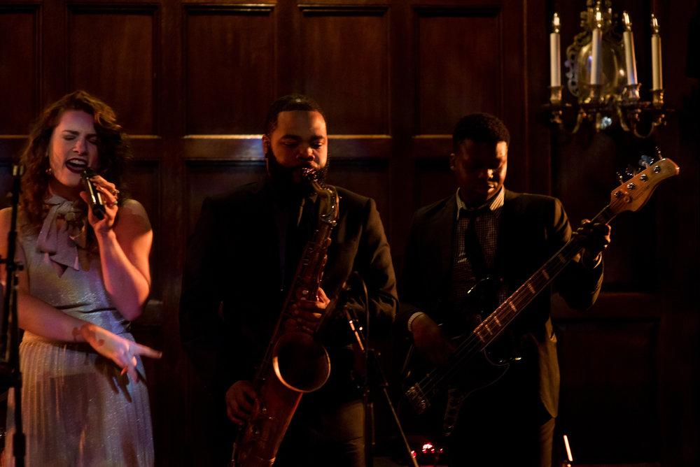 Devin-Dan-Winter-Wedding-Boston- Wedding-Destination-Wedding-Wedding-Planner-Nicole-Simeral-Harvard-Club-Decor-Flowers-Candles-Candlelight-Luxury-wedding-burgundy-purple-gold-wedding -band