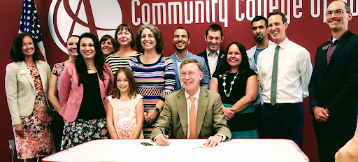 Photo at the Community College of Aurora with Governor Hickenlooper at the In-State tuition for Refugees, Combat Interpreters and Other Foreign Nationals Bill signing.