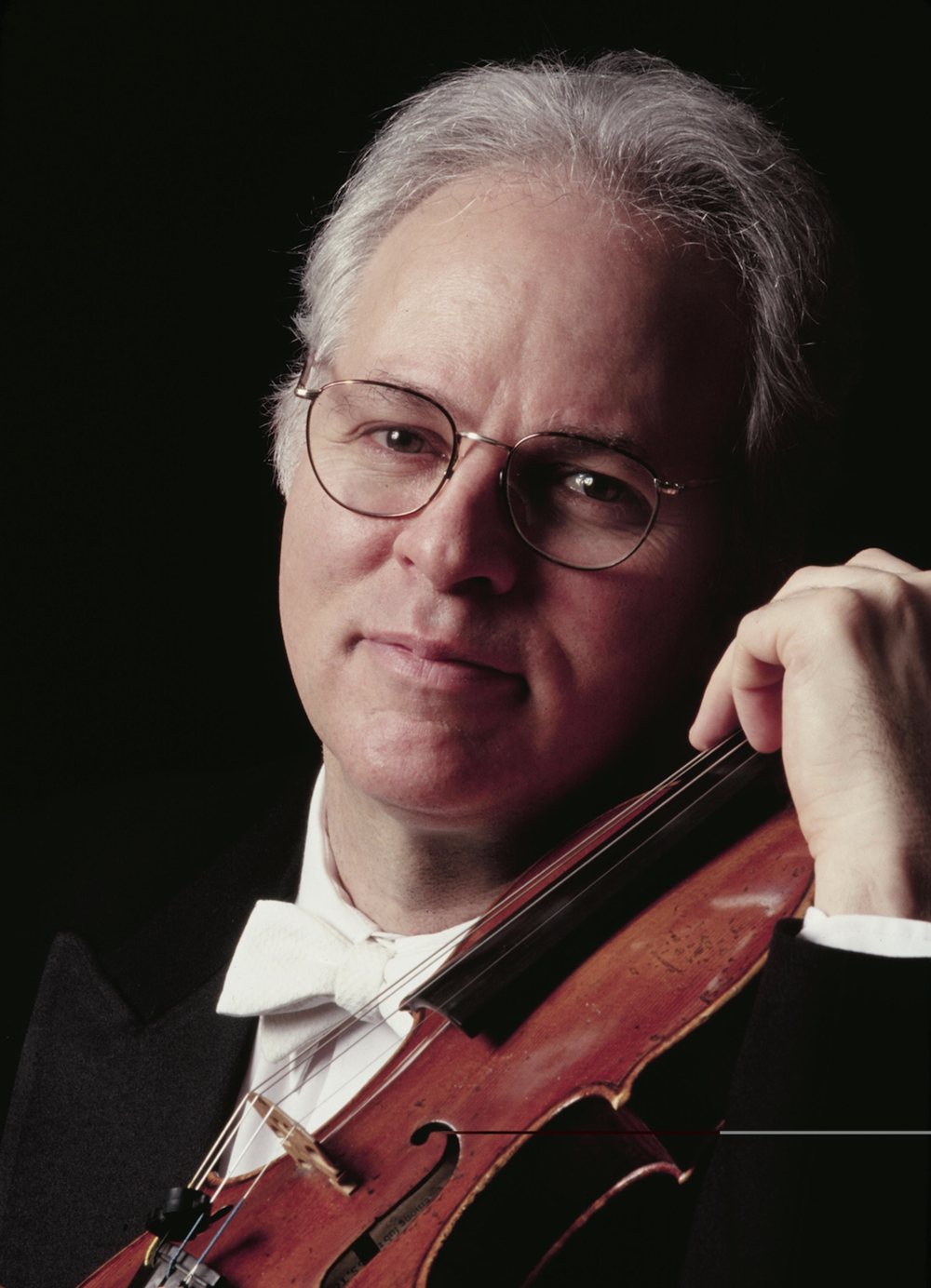 Joel Smirnoff - Joel Smirnoff, conductor and violinist, is President of the Cleveland Institute of Music. He is a native of New York City and former chair of the violin department at The Juilliard School. He has been a member of the Juilliard String Quartet since 1986, and the ensemble's leader since 1997. The Quartet, founded in 1947, has become a living American legend and won four GRAMMY Awards.Formerly the group's second violinist, Mr. Smirnoff attended the University of Chicago and The Juilliard School and was a member of the Boston Symphony Orchestra for six years. Second Prize-winner in the International American Music Competition in 1983, he made his New York recital debut in 1985 at Carnegie's Weill Recital Hall as part of the Emerging Artists series and at Town Hall as part of the Midtown Masters series. In 1997, he was featured violin soloist at Tanglewood in a concert dedicated to the memory of violinist Louis Krasner, performing the Berg Violin Concerto under the direction of Bernard Haitink. Mr. Smirnoff has participated in the world premiere of numerous contemporary works, many of which were composed for him. Mr. Smirnoff is a Sony recording artist and has solo recordings on GM, CRI and Northeastern Records.Mr. Smirnoff has served as Chair of the Violin Department at The Juilliard School since 1993 and served as Head of String Studies at the Tanglewood Music Center during the late 1990s. Mr. Smirnoff has been on the faculty of Tanglewood since 1983. He has served on the juries of the Naumburg and Indianapolis Violin Competitions. He also pursues an active career as a conductor, both in the U.S. and abroad. In the summer of 2000, Mr. Smirnoff made his official American conducting debut with the San Francisco Symphony, conducting an all-Tchaikovsky program. He has also been a frequent guest with the New World Symphony and the Tanglewood Music Center Orchestra. In May 2004, he received rave reviews for his debut with the St. Paul Chamber Orchestra, replacing Peter Oundjian, who had fallen ill. In Europe, Mr. Smirnoff has conducted the Norwegian Chamber Orchestra and a European tour with the Basel Sinfonietta and Charles Rosen as soloist in the Elliott Carter Piano Concerto. Mr. Smirnoff has led both the Juilliard Symphony and the Juilliard Orchestra in concert. He has also appeared in concert with the Louisiana Philharmonic, the Phoenix Symphony, the Chicago Philharmonic, the Western New York Chamber Orchestra and the Texas Music Festival Orchestra. Mr. Smirnoff also plays jazz, performing frequently as improvising soloist with Tony Bennett. His solos were featured on the GRAMMY Award-winning CD Tony Bennett Sings Ellington Hot and Cool. He has also been guest soloist with Gunther Schuller and the American Jazz Orchestra, as well as the Billy Taylor Trio.Mr. Smirnoff was born into an eminent New York musical family. His mother sang with the Jack Teagarden Band under the stage name of Judy Marshall and his father, Zelly Smirnoff, played in the NBC Symphony under Toscanini and was second violinist of the Stuyvesant String Quartet. Mr. Smirnoff has been president of CIM since 2008.
