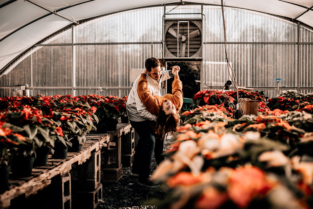 For these two's Christmas photos, we headed over to a greenhouse full of Poinsettias & it was such a unique and fun location, I loved doing these! Also, this couple totally rocked it in front of the camera! I barely even had to tell them what to do - they were so comfortable and it was just such a fun and relaxed time!