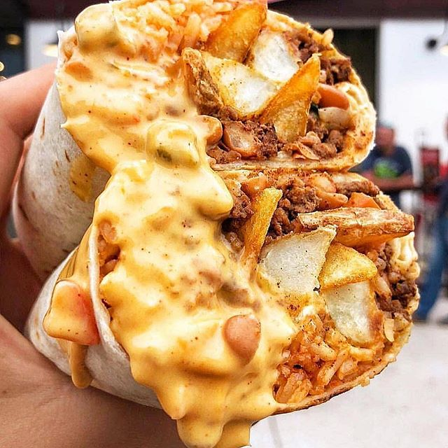 Burritos 🌯 are not meant to be handled easily! • • • • • • • • • #mexican #alpastor #burrito #enchiladas #mexicanfood #mexicanrestaurant #nachos #quesadillas #streettacos #tacos #taquitos #burritos #cheeselover #cheesey #delicious #eat #mozarella #salami #sandwhich #sandwiches #sausage #sourcream #eating #eats #foodaddict #foodgasm #cheese