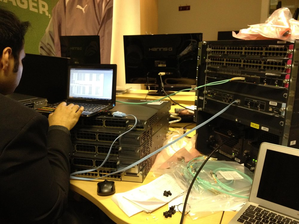 Our senior engineer Fawad setting up a Cisco core switch and 2 access switch stacks