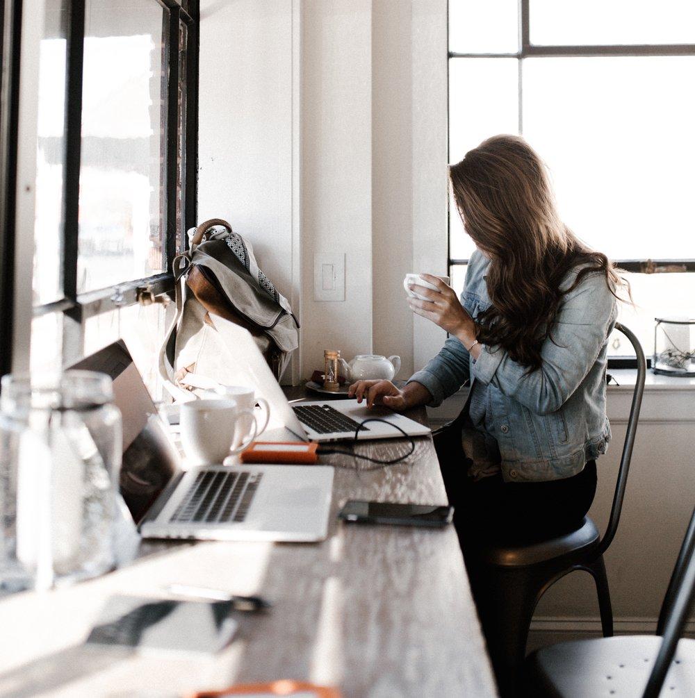 Woman Using Laptop to Plan Her Custom Software