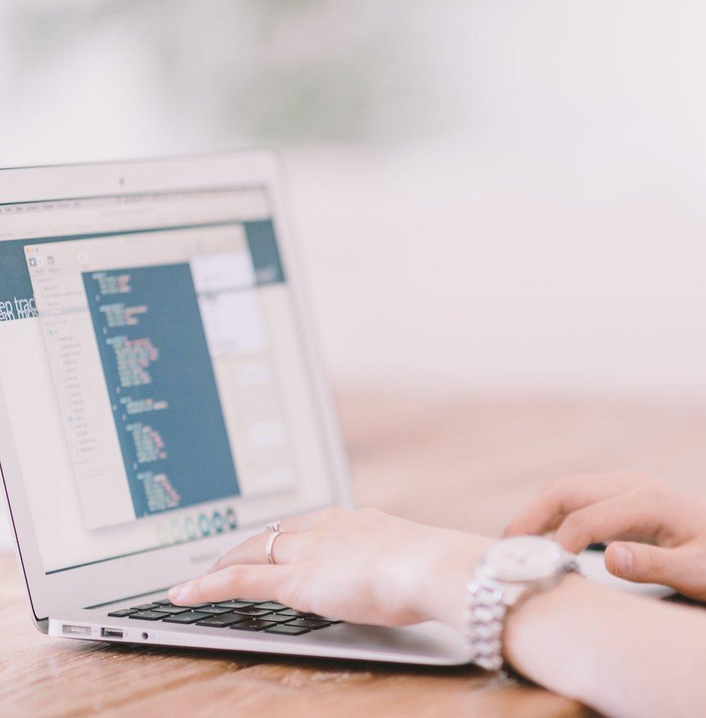 Hands of Female Custom Software Developer on Laptop