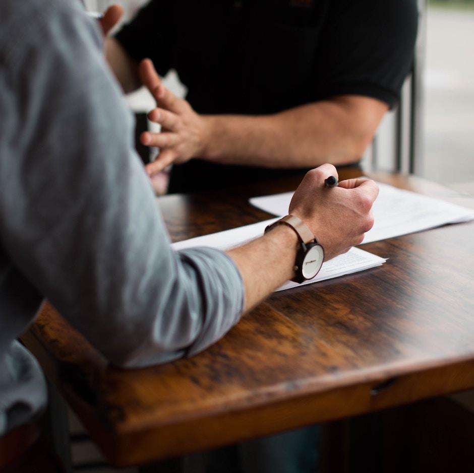 Hands of Man Interviewing Custom Software Developer