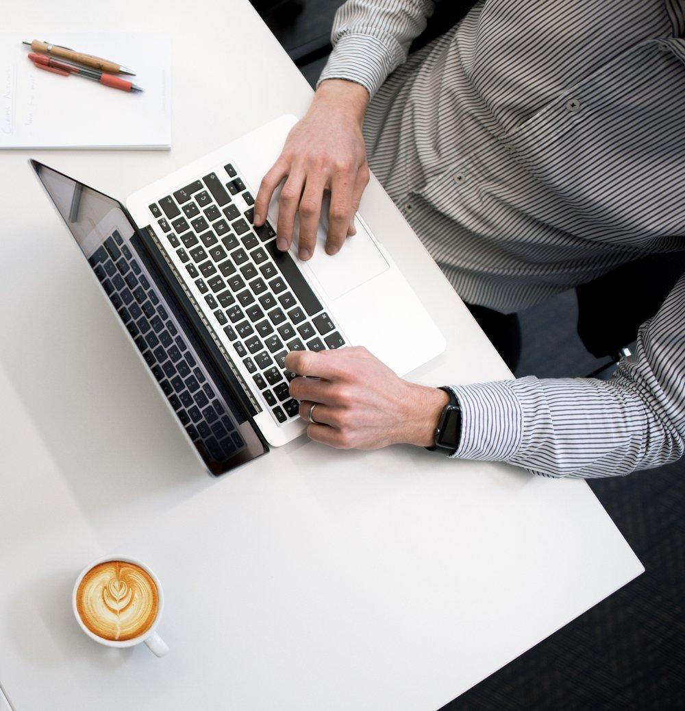 Hands of Male Custom Software Developer on Macbook