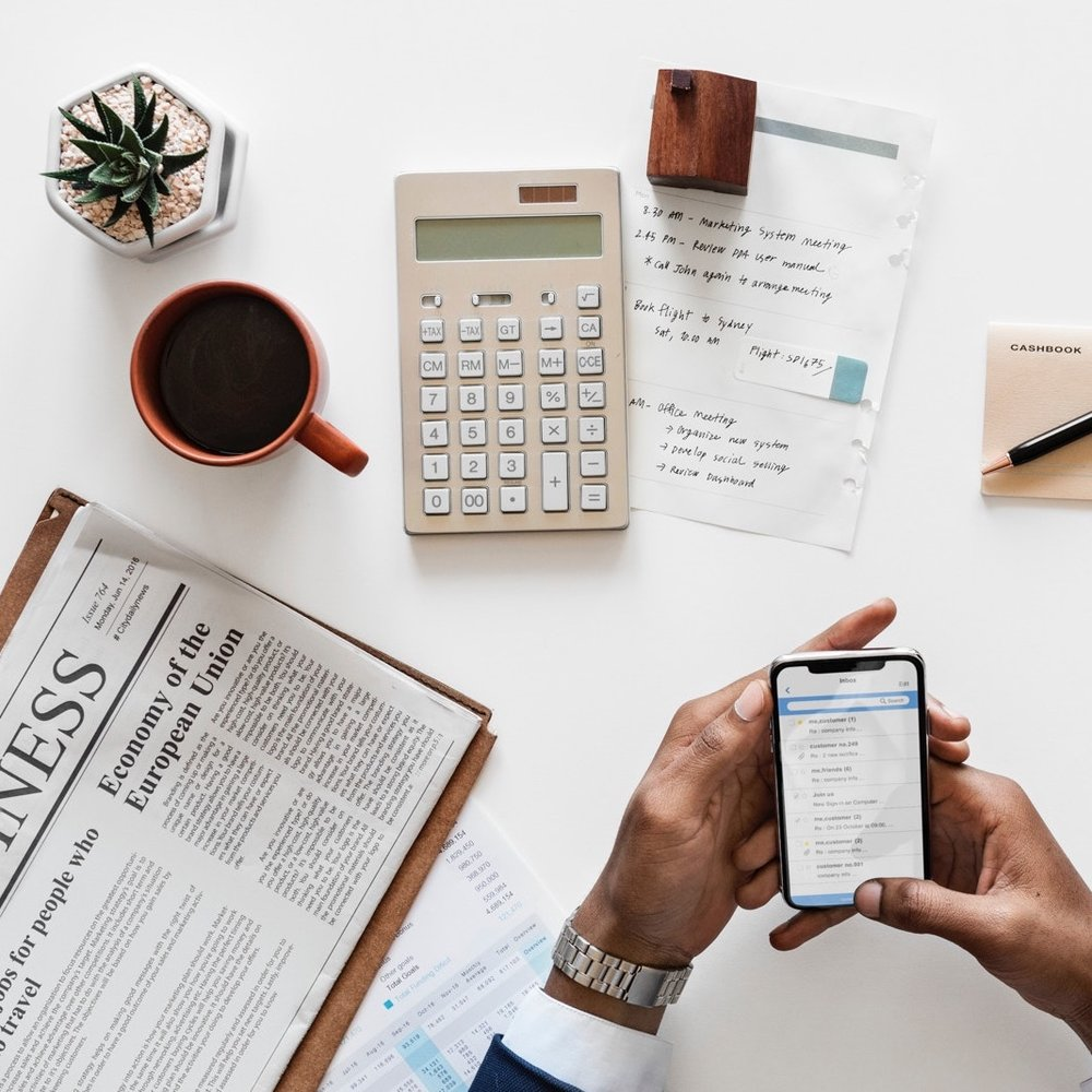 Businessmans Hands Holding Smartphone with Other Desk Supplies