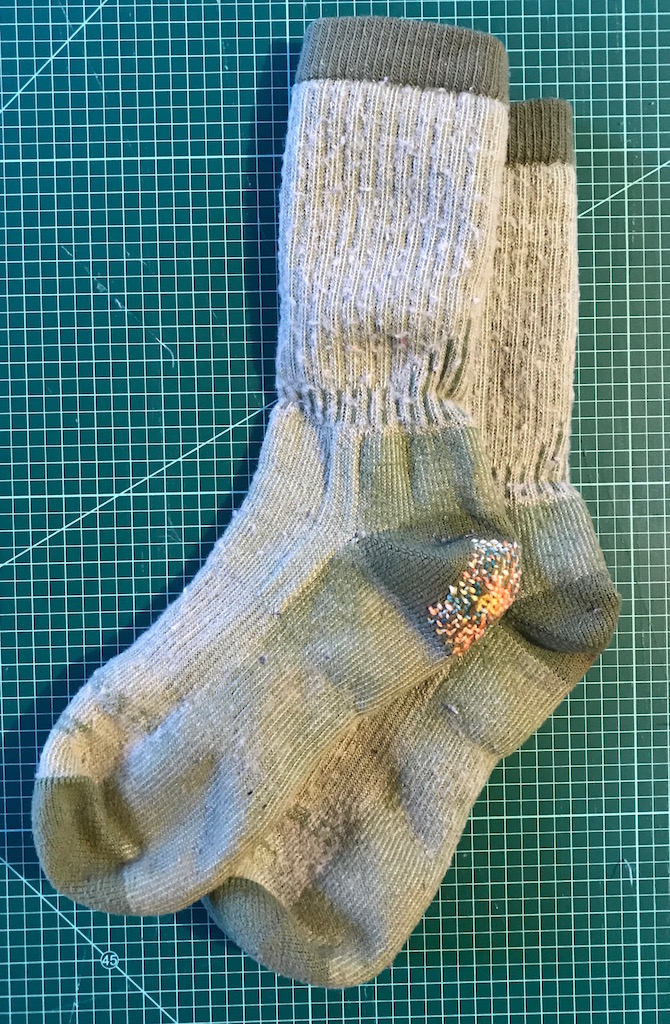 Decorative darn on the heel of thick wool socks.