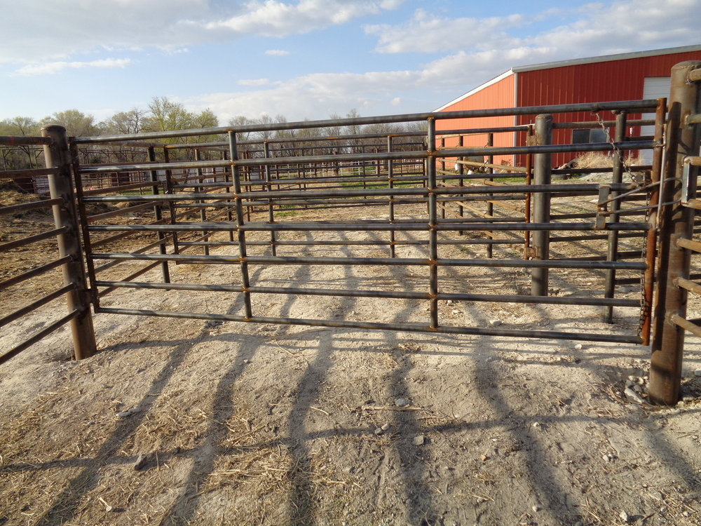 This gate had a cowboy latch from Plus One Manufacturing, it also has the chain latch on it.