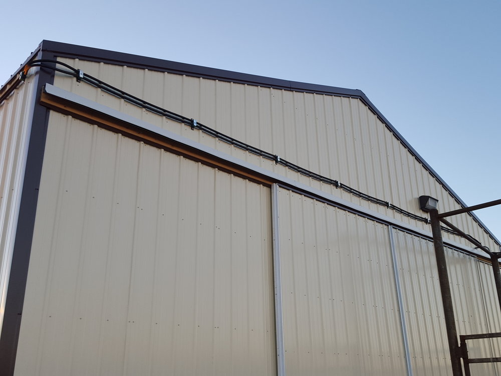 Hydraulic hoses mounted on a building. It is not uncommon to have 200' of hoses on even a small system.