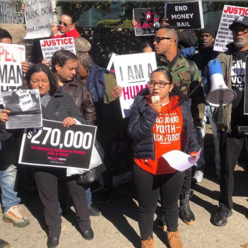"Protestors fight back against Queens DA's ""punitive policies"" of targeting poor, minority communities"