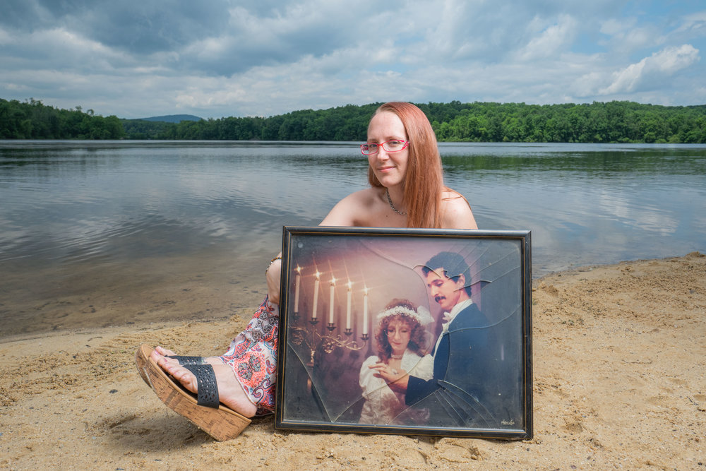 Andrea on a beach (one of her fathers favorite places) with a picture of her parents on their wedding day.