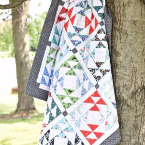 kaleidoscope-windows-quilt-in-tree-1.jpg