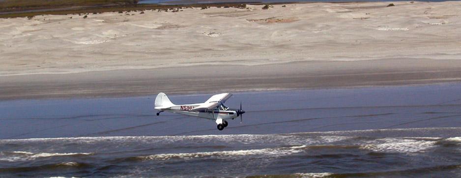 husky airplane over beach