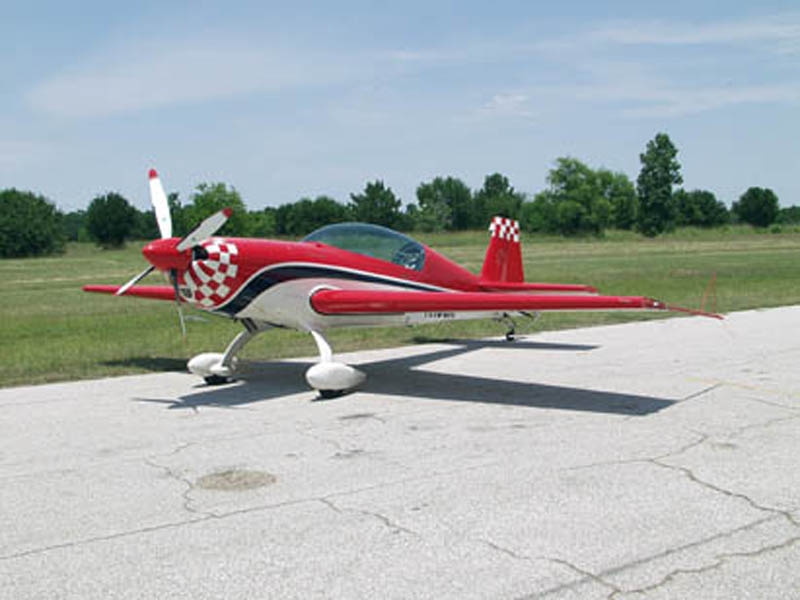 Extra 300 airplane on runway