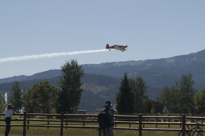 Extra 300 airplane with smoke