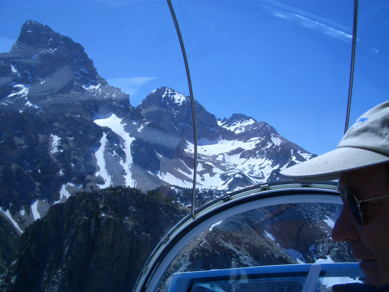 Bell 47 flying in the tetons