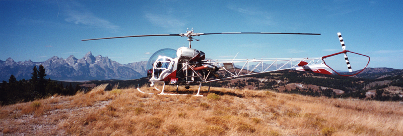 Bell 47 landed with tetons in background