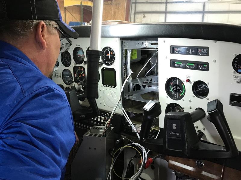 mechanic working on aircraft avionics